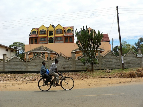A boda boda operator and his customer