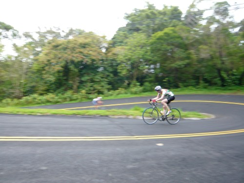 Katharina checking out eventual winner Shannon Cutting, while rounding one of the hairpins on Tantalus